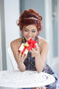 Beautiful young woman opening gift box thai ethnicity Stock Image
