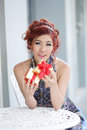 Beautiful young woman opening gift box thai ethnicity Stock Images