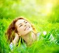 Beautiful young woman outdoors enjoying nature Stock Photos