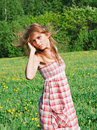 Beautiful young woman outdoors romantic model in field long hair blowing Royalty Free Stock Images