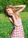 Beautiful young woman outdoors romantic model in field long hair blowing Stock Photo