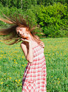 Beautiful young woman outdoors romantic model in field long hair blowing Royalty Free Stock Photo