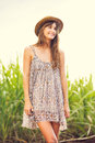 Beautiful Young Woman Outdoors in Sun Dress Stock Photo