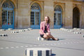 Beautiful young woman in Palais Royale in Paris Royalty Free Stock Photo