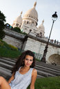 Beautiful young woman in paris outside the historical sacre coeur cathedral Royalty Free Stock Photo