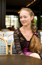 Beautiful young woman in Parisian cafe Royalty Free Stock Photos