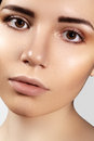 Beautiful young woman with perfect clean shiny skin, natural fashion makeup. Close-up woman, fresh spa look Royalty Free Stock Photo