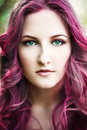 Beautiful young woman with pink hair and green eyes in the park Stock Photos