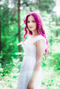 Beautiful young woman with pink hair in the park Royalty Free Stock Photos