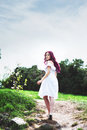Beautiful young woman with pink hair in the park in white dress Royalty Free Stock Images