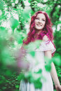Beautiful young woman with pink hair in the park in white dress Stock Image