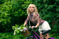 Beautiful young woman portrait with bicycle in the park Royalty Free Stock Photos