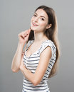Beautiful young woman portrait cute tender pure smiling posing gray background Royalty Free Stock Photo