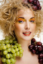Beautiful young woman portrait excited smile with fantasy art hair makeup style fashion girl creative food fruit orange Stock Photography