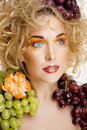 Beautiful young woman portrait excited smile with fantasy art hair makeup style fashion girl creative food fruit orange Royalty Free Stock Photos