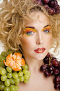 Beautiful young woman portrait excited smile with fantasy art hair makeup style fashion girl creative food fruit orange Stock Images