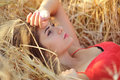 Beautiful young woman portrait in hay field Royalty Free Stock Photo