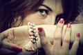 Beautiful young woman portrait with jewellery close up eyes focus fashion beauty Stock Photography