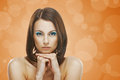 Beautiful young woman portrait of on orange background Royalty Free Stock Image