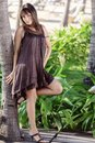 Beautiful young woman poses tropical garden Royalty Free Stock Image