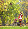 Beautiful young woman posing in park with her bicycle shot tilt and shift lens Stock Image