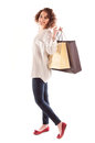 Beautiful young woman posing with shopping bags isolated on white background Royalty Free Stock Photo