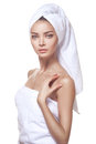 Beautiful young woman posing in white towel spa healthcare isolated over Royalty Free Stock Photography