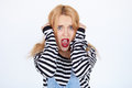 Beautiful young woman prisoner isolated on a white background shocked blonde girl wearing striped prison clothes screaming Royalty Free Stock Photo
