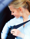 Beautiful young woman putting on her seat belt Royalty Free Stock Photo