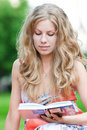 Beautiful young woman read book Stock Image