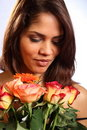 Beautiful young woman receives rose flowers Stock Photo