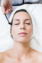 Beautiful young woman receiving antiaging treatment in spa portrait of Royalty Free Stock Photos
