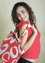 Beautiful young woman with red bag Stock Images