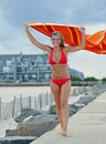 Beautiful young woman in red bikini - with towel Royalty Free Stock Images