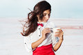 Beautiful young woman with red bow tie portrait of holding cup outdoor Royalty Free Stock Image