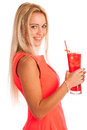 Beautiful young woman in red dress with a glass of ice tea isolated over white background Royalty Free Stock Images