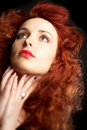Beautiful young woman with red hair Stock Photo