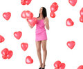 Beautiful young woman with red heart balloon Royalty Free Stock Photography