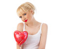 Beautiful young woman with red heart balloon Stock Image