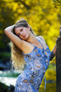 Beautiful young woman relaxing on nature. Royalty Free Stock Photography