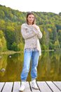 Beautiful young woman relaxing near a lake on in autumn landscape Stock Photos