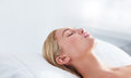 Beautiful young woman relaxing at spa close up shot of on massage table female lying with her eyes closed Stock Photography