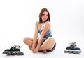 Beautiful young woman with roller skates Stock Image