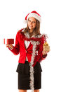 Beautiful young woman in santa claus dress standing isolated ove over white with christmas presents Royalty Free Stock Image