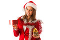 Beautiful young woman in santa claus dress standing isolated ove over white with christmas presents Stock Photos
