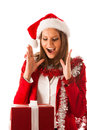 Beautiful young woman in santa claus dress standing isolated ove over white with christmas presents Royalty Free Stock Photos