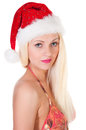 Beautiful young woman in a santa hat and bikini posing over white background Stock Photography