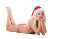 Beautiful young woman in a santa hat and bikini posing over white background Stock Images