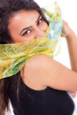 Beautiful young woman with a shawl partially covering her face on white background Stock Photography