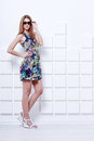 Beautiful young woman in short colorful dress Royalty Free Stock Photo